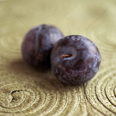 Food  beverage : Close up of two plums