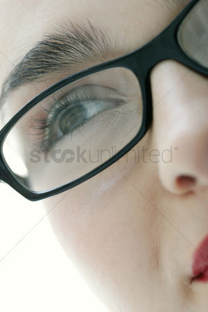 Bespectacled : Close-up picture of a lady s face with black rimmed spectacles