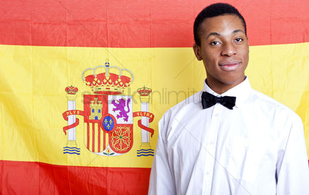 Respect : Close-up portrait of young man against spanish flag