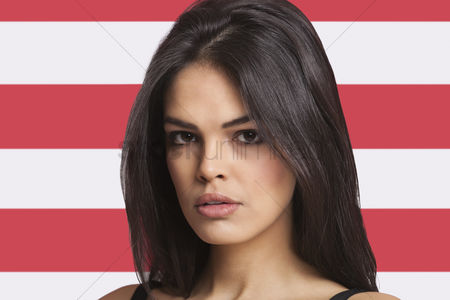 Respect : Close-up portrait of young woman against american flag