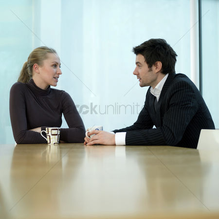 Business suit : Colleagues chatting leisurely