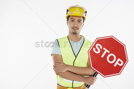 Masculinity : Construction worker holding a stop