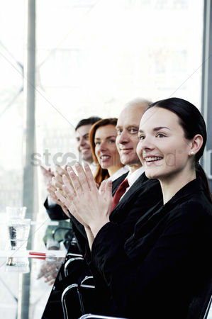 Lively : Corporate people clapping hands in the meeting room