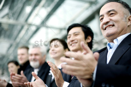 Determined : Corporate people clapping hands