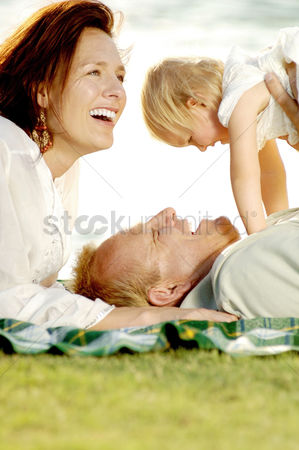 Adorable : Couple and their lovely daughter having fun in the park