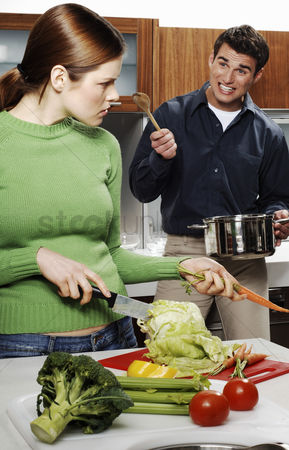 Husband : Couple arguing while cooking in the kitchen