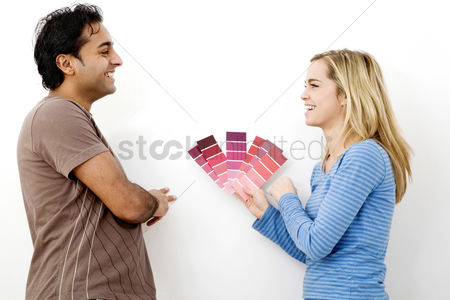 Selection : Couple choosing suitable colour from the colour chart