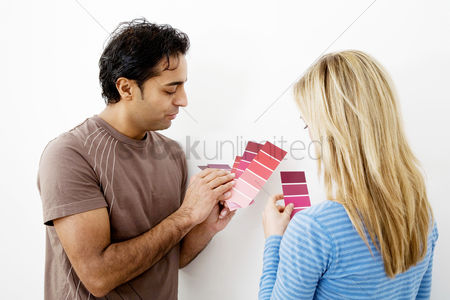 Choosing : Couple choosing suitable colour from the colour chart