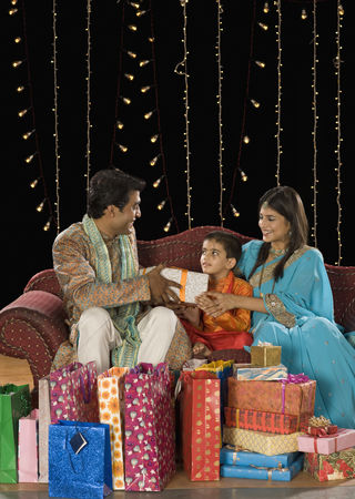 Diwali : Couple giving gifts to their son on diwali festival