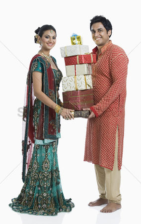 Diwali : Couple holding gifts on diwali