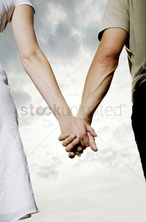 Two people : Couple holding hands