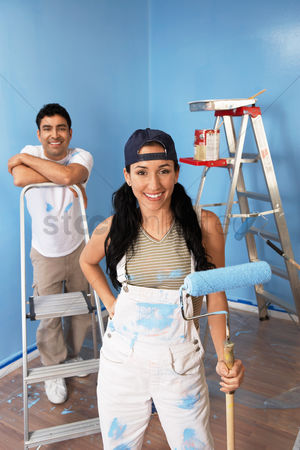 Arts : Couple in freshly painted room portrait elevated view