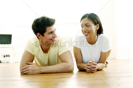 Lying forward : Couple lying forward on the floor