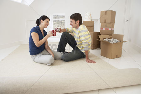 Two people : Couple moving into new home