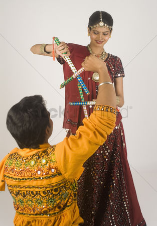 Dance : Couple performing dandiya