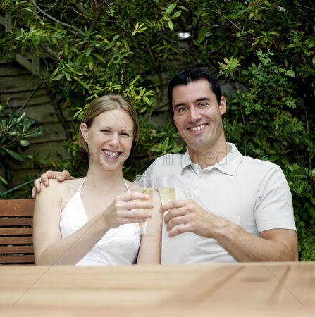 Celebrating : Couple proposing a toast