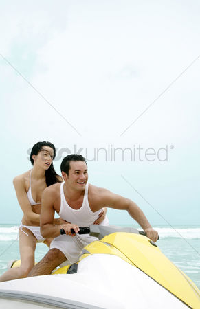 Jet ski : Couple riding on jet ski