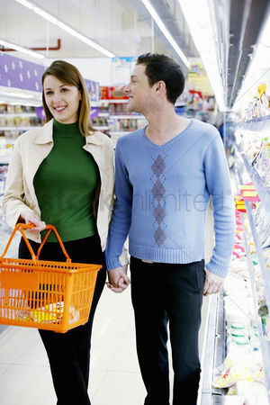 Supermarket : Couple shopping in the supermarket
