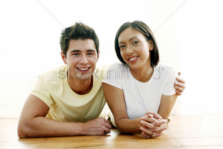 Lover : Couple smiling while lying forward in the park