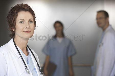Looking at camera : Doctor in elevator portrait