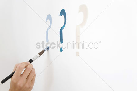 Paint brush : Drawing question mark on white wall