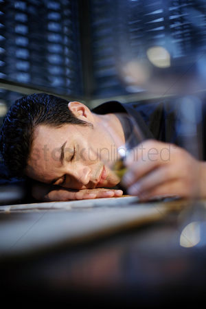 Worry : Drunken man sleeping with his head on the table