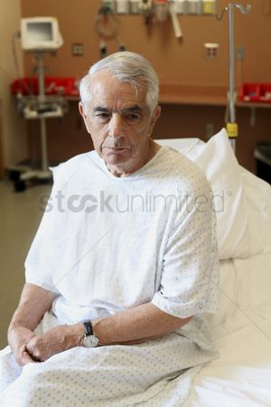Appearance : Elderly man sitting on hospital bed