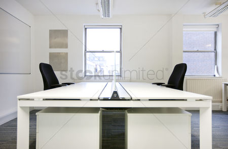 Tidy : Empty office desks back to back
