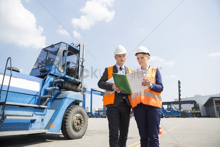 Forklift : Engineers reading file in shipping yard