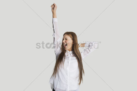 White hair : Excited woman with arm raised screaming against white background