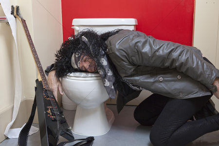 Jacket : Exhausted senior male guitarist sleeping in toilet