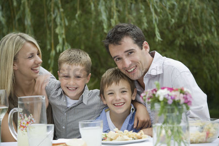 Posed : Family having picnic in park
