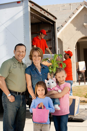 Group portrait : Family in front of removal van and house portrait