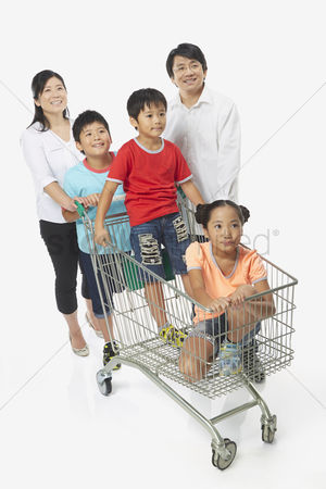 Pushing : Family of five shopping together
