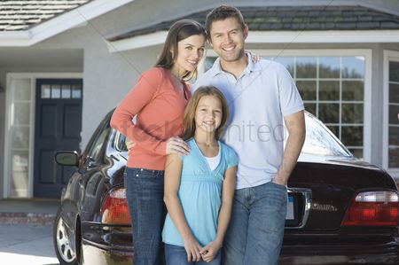 Cheerful : Family outside house with car