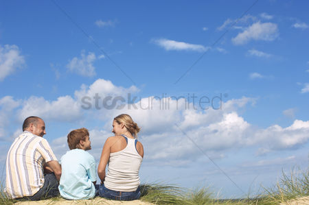 Blank : Family sitting on dunes