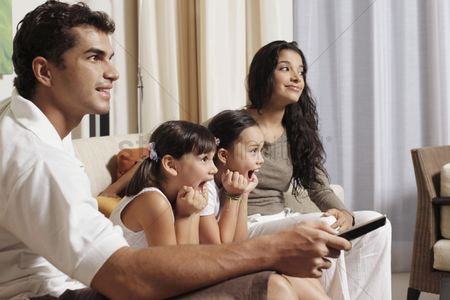 Remote : Family watching tv together