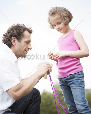 Rope : Father and daughter together with skipping rope