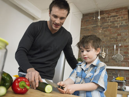 Offspring : Father and son  3-4  preparing food in kitchen