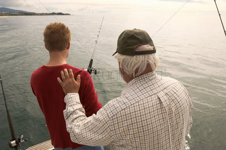 Offspring : Father and son fishing on boat