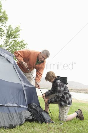 Pitch : Father and son pitch a tent