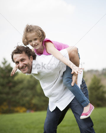Excited : Father giving young daughter piggyback ride