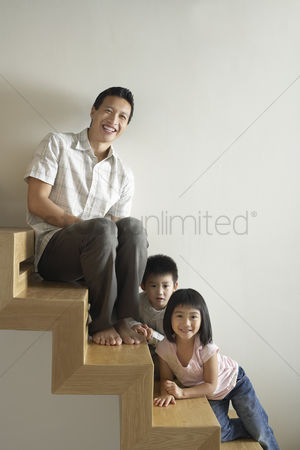 Staircase : Father sitting with children on wooden staircase