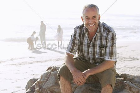 Smiling : Father with family at beach
