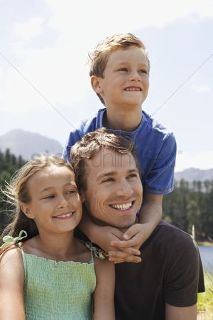 Children : Father with two children outdoors