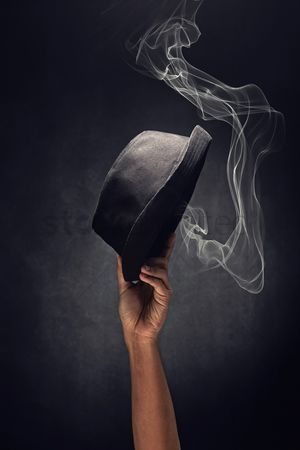 Black background : Fedora held up high