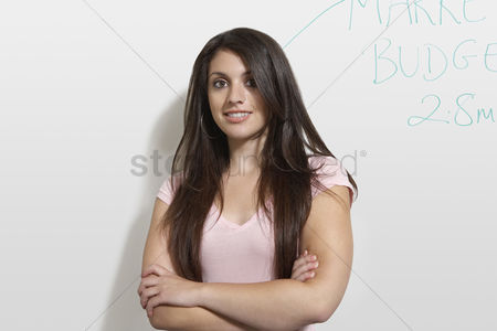 Pupil : Female student standing by white board portrait