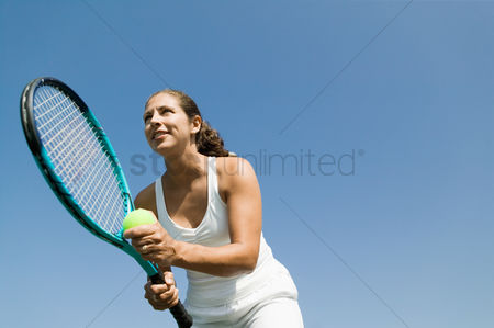 Spirit : Female tennis player preparing to serve low angle view