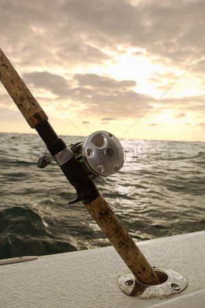 Moody : Fishing rod in holder on boat  close-up