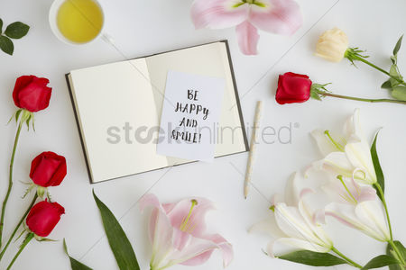 Blank : Flatlay of white background with flowers and journal